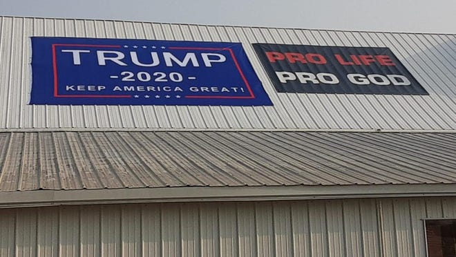 This sign placed on the roof of the Et Cetera Shop in Yoder by the building's owner has prompted the occupant to leave out of fear of losing its nonprofit status.