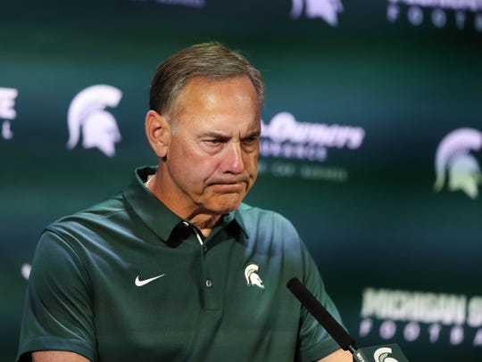 Michigan State head coach Mark Dantonio talks with