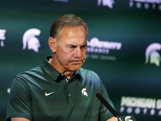 Michigan State head coach Mark Dantonio talks with