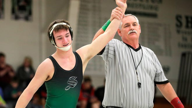 Shiocton High School's Sam VanStraten has his arm raised after defeating Manawa High School's Bryan Griffin Thursday, Jan. 25, 2018, in Shiocton, Wis.