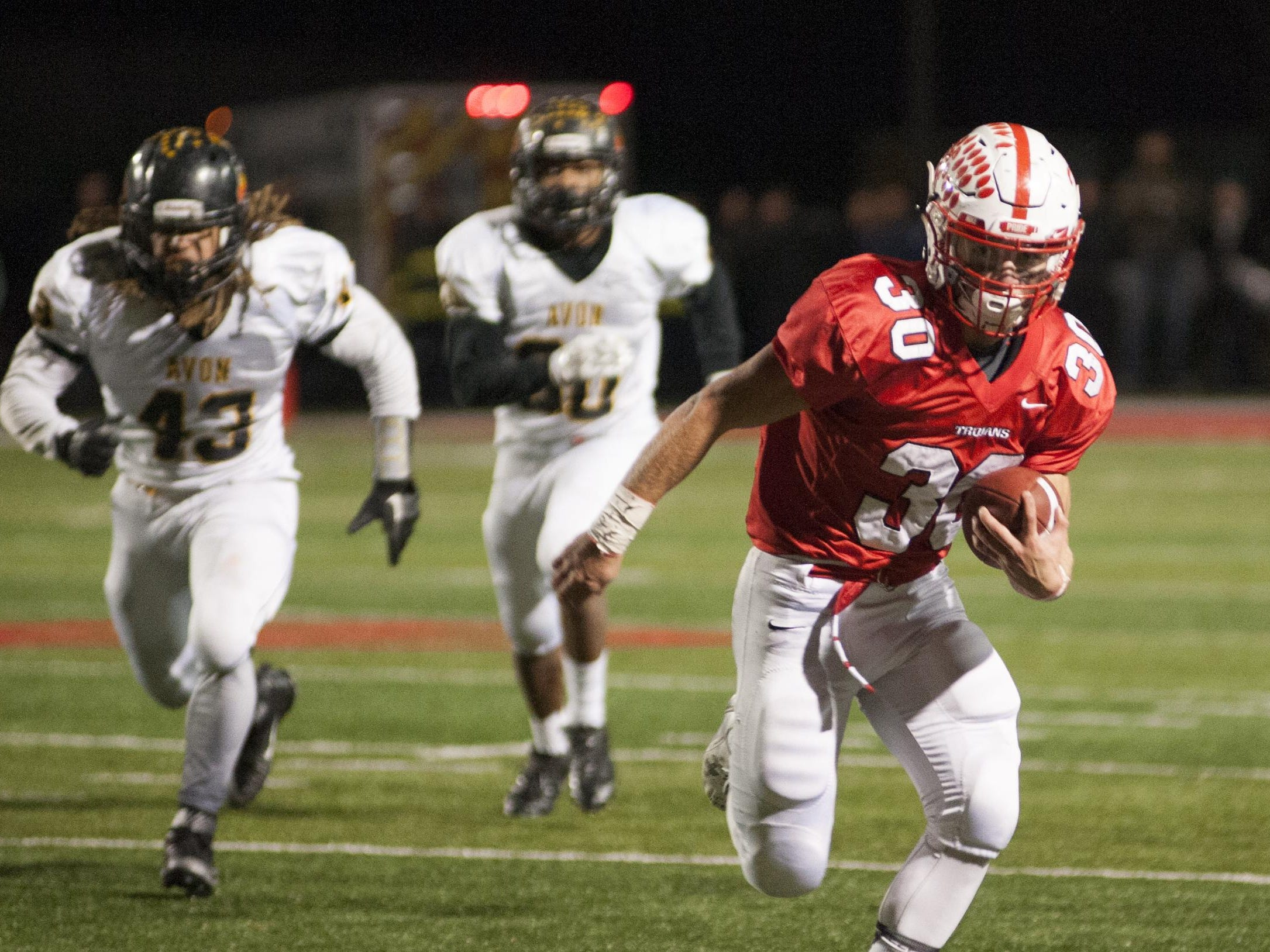 Center Grove running back Titus McCoy (30) advances past Avon players during the Class 6A semistate playoff game Nov. 13, 2015, in Greenwood.
