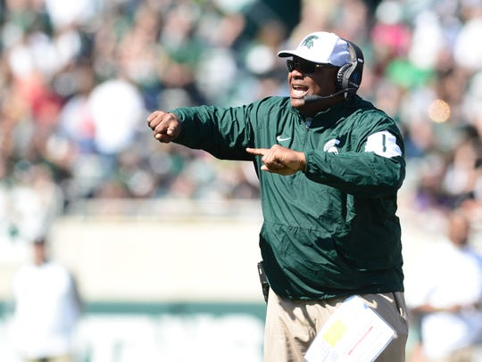 Michigan State assistant coach Ron Burton yells to