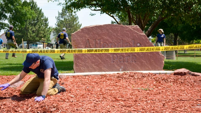 Investigators with the special task force investigating a series of Northern Colorado shootings on comb through Allendale Park in Loveland, Colorado Thursday, June 25, 2015.