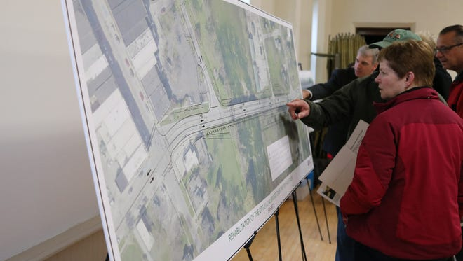 Elmore residents check out the plan for the $9 million rehabilitation project of the bridge on Ohio 51 over the Portage River. The Ohio Department of Transportation is set to begin the project in the spring of 2020.