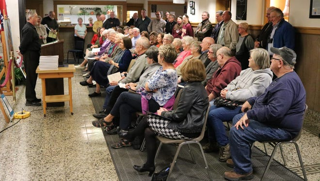 Patrick O'Keeffe, author of 'History of Ottawa County,' speaks about the researching, writing and editing process for the new book to a packed crowd at the courthouse on Tuesday.