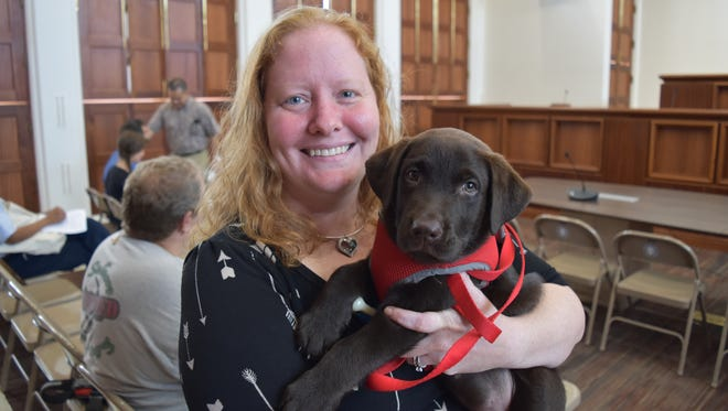 Elementary school teacher Shannon Seleen is shown with Donne', who is training to be her service dog, at the Guam Congress Building in Hagåtña on April 6, 2017. Seleen testified in support of Bill 17, related to animal-assisted interventions.