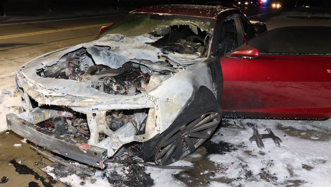 This car burned on Guns Road in Bellevue following an exchange of gunfire Friday night