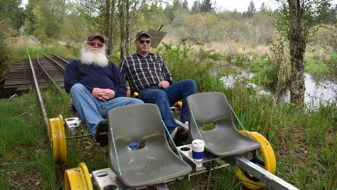 From left, Bob Sherer and Vance Creek Railriders operator Doug Newman enjoy the scenery of rural Mason County on a rail ride in early May. Vance Creek Railriders opens Monday, May 21, to the public, with rides at 9 a.m., noon and 3 p.m.
