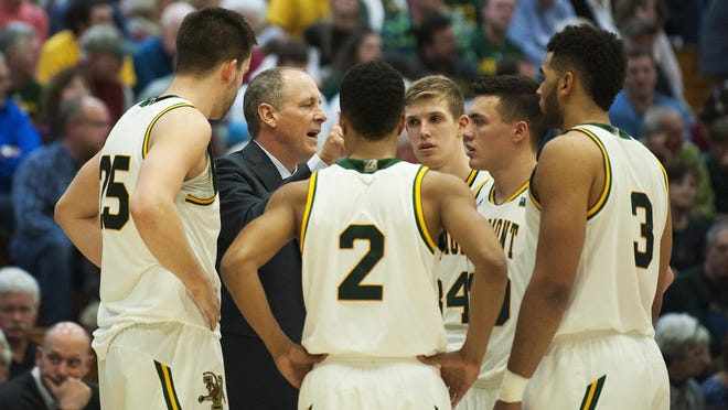 Vermont head coach John Becker talks to the team during a timeout during the men's basketball game between the Harvard Crimson and the Vermont Catamounts at Patrick Gym last week.