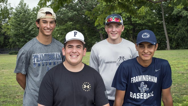 Framingham High Class of 2020 graduates (from left) Andrew Keane, Brian O'Donnell, Luke Spring and Nick Parga recently started The Big 4 Podcast. They got together for pictures at Bowditch Field in Framingham.