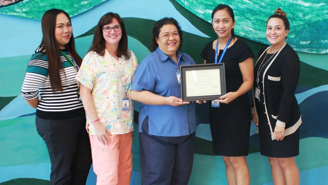 From left: Guam Regional Medical City's Jasmine Aguas, clinical educator; Jennifer Turner, clinical educator; Jemmabeth Simbillo, lead clinical educator; Kathleen Ho, chief nursing officer; and Abby Crain, people relations administrative assistant.