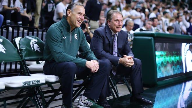 Michigan State coaches Mark Dantonio, left, and Tom Izzo.