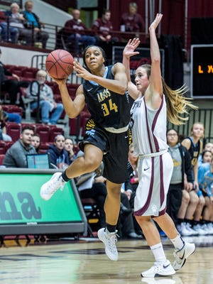 Nneka Nnadi puts up a shot in an Argo loss to the University of Montana