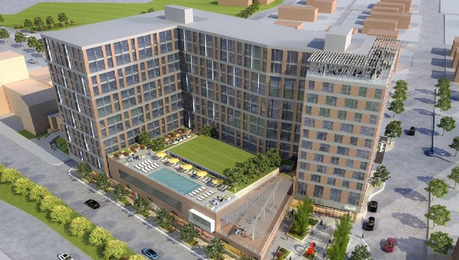 A rendering of the 12-story hotel and luxury apartments proposed on the corner of Grand River Avenue and Abbott Road in downtown East Lansing.