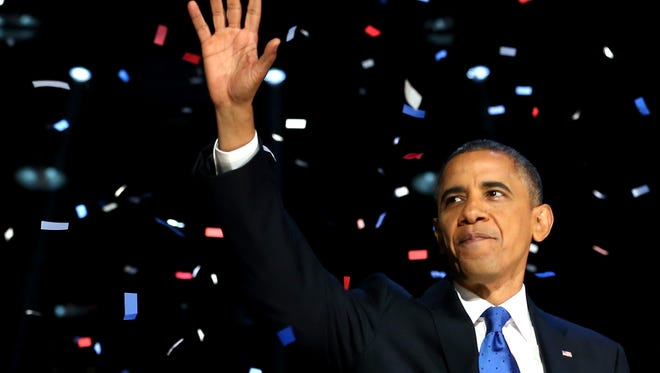 President Obama waves to supporters after his victory speech on Nov. 6, 2012, in Chicago/