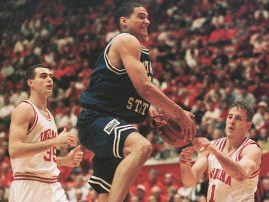 Indiana State's Nate Green, center, goes up to score between Indiana's Kirk Haston, left, and Dane Fife, right, in the first half of the Indiana Classic championship game in Bloomington, Dec. 11, 1999.