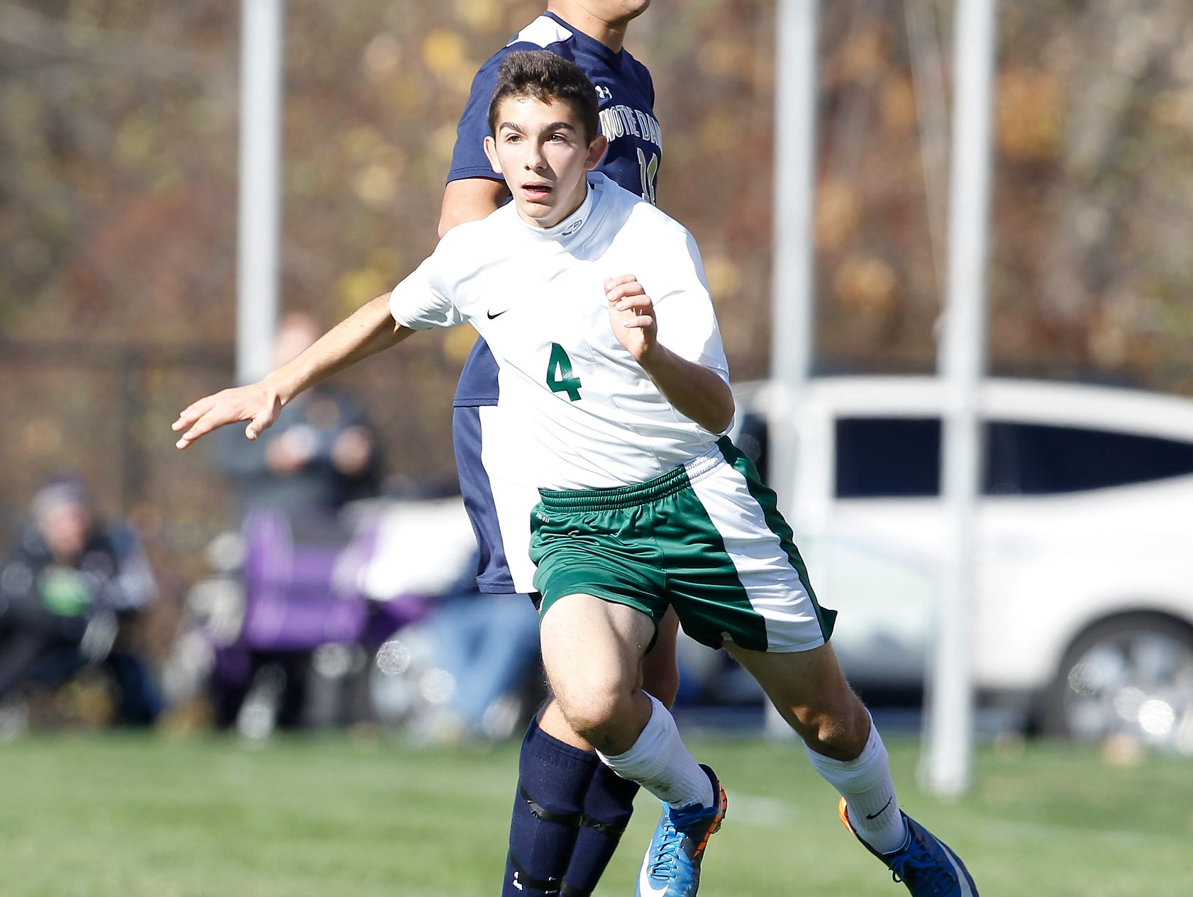 Solomon Schechter's Eitan Abecassis (4) works around a defender during their 9-1 loss to Notre Dame in the NYSPHSAA boys class C soccer final at Middletown High School on Sunday, Nov. 15, 2015.