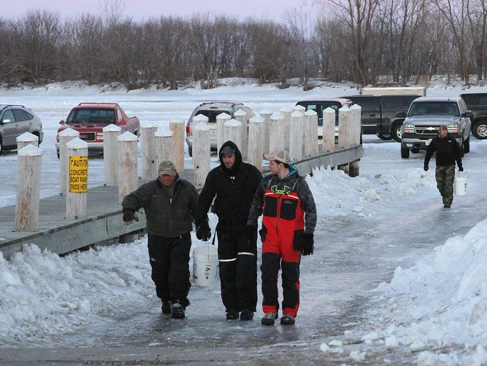 Local ice fisherman catty their catch in from the lake