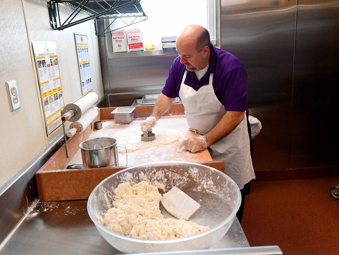 Dale Haywood, franchise director of operations, cuts