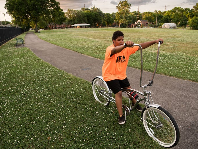 Dezmond Robertson, 14, tries out a bike at Edgehill