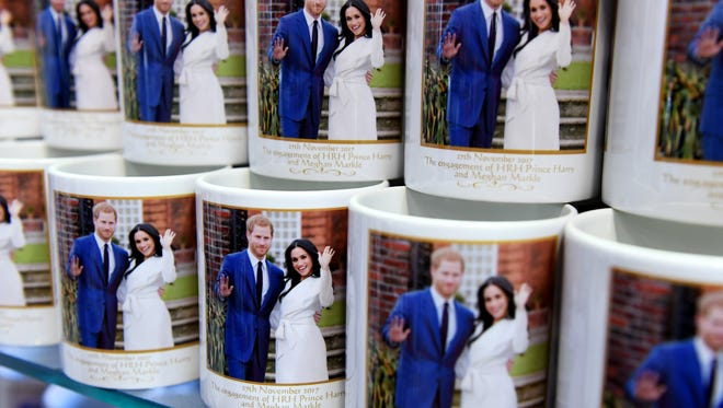 Mugs marking the wedding of Prince Harry and his fiancee Meghan Markle are on display at a souvenir shop in London.