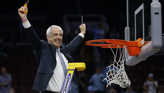 North Carolina head coach Roy Williams reacts after cutting the net after a regional final men's college basketball game against Notre Dame in the NCAA Tournament, Sunday, March 27, 2016, in Philadelphia. North Carolina won 88-74 to advance to the Final Four. (AP Photo/Matt Rourke)