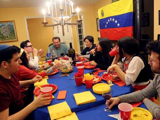 Solomon and Sara Fuerst host a Venezuelan themed Purim celebration for family March 1, 2018 in New Hempstead. Sara Fuerst was born in Israel and grew up in the Caribbean and Venezuela with her Orthodox Jewish family.