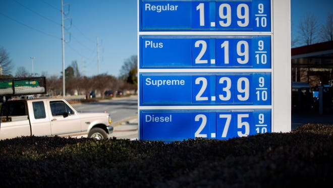A gasoline station advertises prices in Atlanta on Jan. 25.