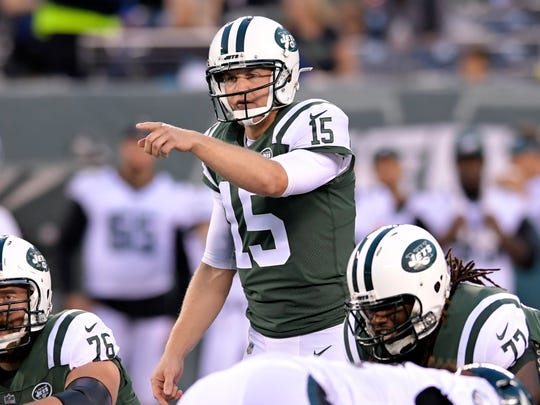 FILE - In this Aug. 31, 2017, file photo, New York Jets quarterback Josh McCown (15) calls a play against the Philadelphia Eagles during the first half of an NFL football game, in East Rutherford, N.J. McCown's NFL journey began 15 years ago as the fourth of 16 quarterbacks selected in the 2002 draft. He's the only one still playing, and it's been that way for a while. (AP Photo/Bill Kostroun, File)