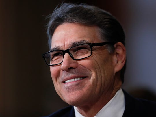 Energy Secretary-designate, former Texas Gov. Rick Perry, smiles as he testifies on Capitol Hill in Washington, Thursday, Jan. 19, 2017, at his confirmation hearing before the Senate Energy and Natural Resources Committee. (AP Photo/Carolyn Kaster)