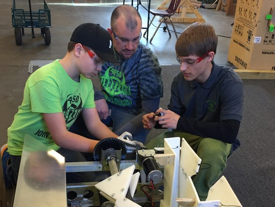 4-H Robotics Club members, left to right, Seth Young,