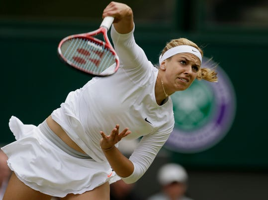 FILE - In this July 1, 2013 file photo, Sabine Lisicki of Germany serves to Serena Williams of the United States in a Women's singles match at the All England Lawn Tennis Championships in Wimbledon, London. The WTA says Lisicki has hit the fastest record serve in the history of the women's tour, reaching 131 mph (211 kph), during her match against Ana Ivanovica at the Bank of West Classic in Stanford, Calif., Tuesday, July 29, 2014. (AP Photo/Alastair Grant, File)