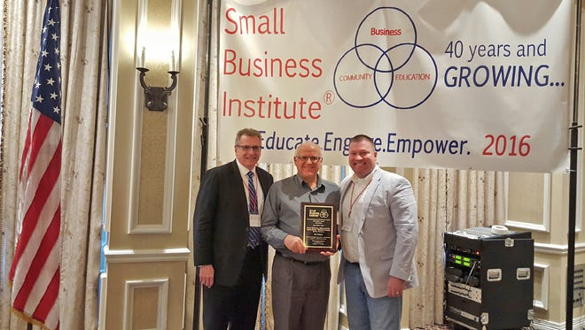 (L-R) Dr. Tim O'Keefe, UWF College of Business dean, Dr. Blaine Lawlor, Department of Management assistant professor, and Michael Myhre, state director of the Florida SBDC Network.