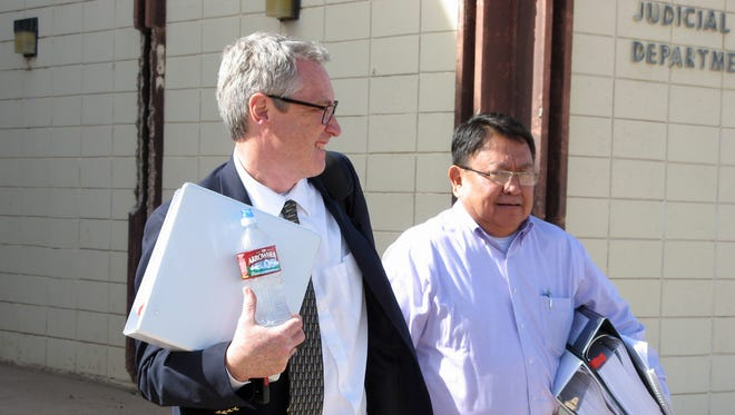 Navajo Nation Council Delegate Mel R. Begay, right, and his attorney, Jeffery Rasmussen, leave Window Rock District Court in Window Rock, Ariz., on earlier this year after the first day of testimony in Begay's trial.