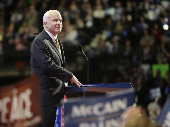 Republican presidential candidate Sen. John McCain listens to the applause of supporters during his nomination acceptance speech on Sept. 4, 2008, the last night of the Republican National Convention in St. Paul, Minnesota.