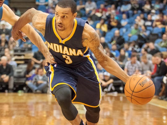 Indiana Pacers point guard George Hill (3) dribbles in the third quarter against the Minnesota Timberwolves at Target Center. The Minnesota Timberwolves won 107-89.
