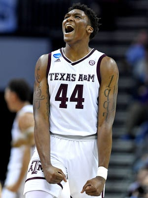 Texas A&M Aggies forward Robert Williams (44) reacts after a play during the second half against the Providence Friars in the first round of the 2018 NCAA Tournament at Spectrum Center.