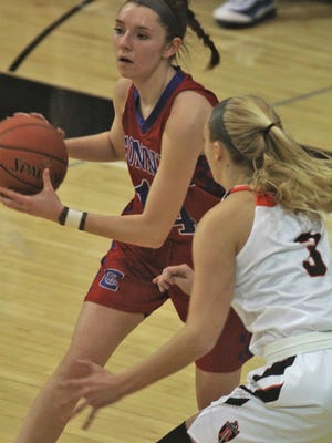Conner senior Savannah Jordan is guarded by Ryle sophomore Brie Crittendon as Conner defeated Ryle 62-57 in a girls basketball game featuring two of the top teams in Kentucky, Feb. 8, 2019 at Ryle HS, Union KY.