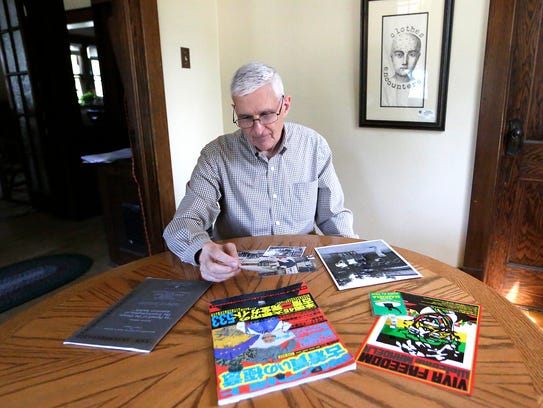 Scott Rodman looks over photos and items he acquired