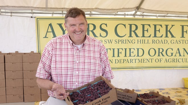 Anthony Boutard, co-owner of Ayers Creek Farm, at Hillsdale Farmers Market in Portland, Ore.