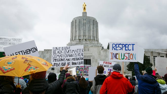 Hundreds gathered at an immigration rights rally in front of the Capitol on Sunday, Feb. 19, 2017, in Salem, Ore. Attendees called for unity and solidarity, and spoke of the contributions that immigrants have made to the United States throughout history.