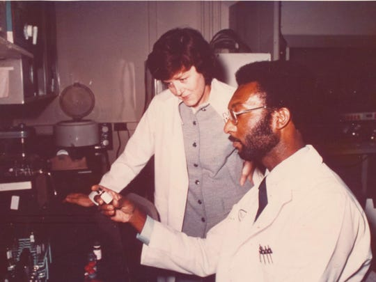 Dr. Carolyn Huntoon is shown working with Myron Johnson in a clinical laboratory in 1976.