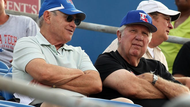 Former Louisiana Tech assistant football coach Mickey Slaughter, right, watches a game with Dr. Billy Bundrick.