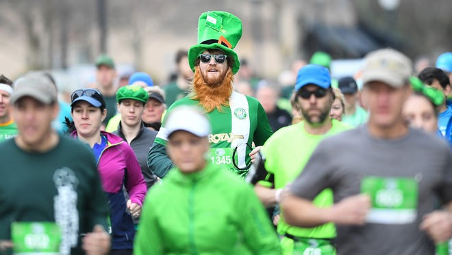 Runners and walkers take part in the St. Paddy's Day Dash & Bash at Fluor Field in downtown Greenville on Saturday, March 17, 2018.