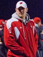 Former Pewaukee player JJ Watt, later a defensive end with the University of Wisconsin Badgers, watches his brother Derek Watt from the sidelines in 2010 as the Pirates face Catholic Memorial in a WIAA playoff game at Pewaukee..