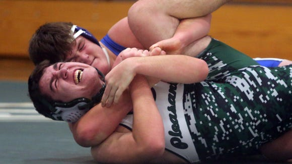 Gannon Duffy of Pearl River, top, defeated Michael Perlleshi of Pleasantville with a major decision in a 220 pound match during a dual wrestling meet between Pearl River and Pleasantville at Pleasantville High School Dec. 13, 2017.