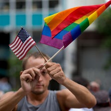 Chaunce O'Connor rallies outside the MIami court house  during the court hearing on gay marriage in Miami, Wednesday, July 2, 2014. Attorneys for gay couples and the state of Florida are squaring off at a hearing on a lawsuit challenging Florida's constitutional ban on same-sex marriage.  Like others filed across the country, the lawsuit contends the gay marriage ban added by voters to the state constitution is discriminatory and violates equal protection guarantees.
