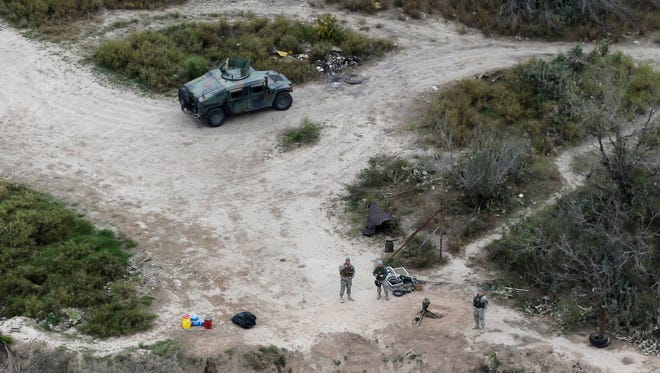 In this Feb. 24, 2015, file photo, members of the National Guard patrol along the Rio Grande at the Texas-Mexico border in Rio Grande City, Texas. The Trump administration is considering a proposal to mobilize as many as 100,000 National Guard troops to round up unauthorized immigrants, including millions living nowhere near the Mexico border, according to a draft memo obtained by the Associated Press.