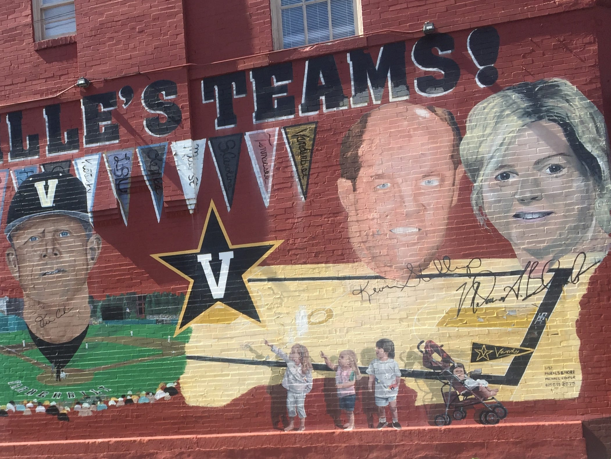 Former Vanderbilt coaches Kevin Stallings and Melanie Balcomb's likenesses are still on the mural on the side of a building on West End and 28th Avenue.