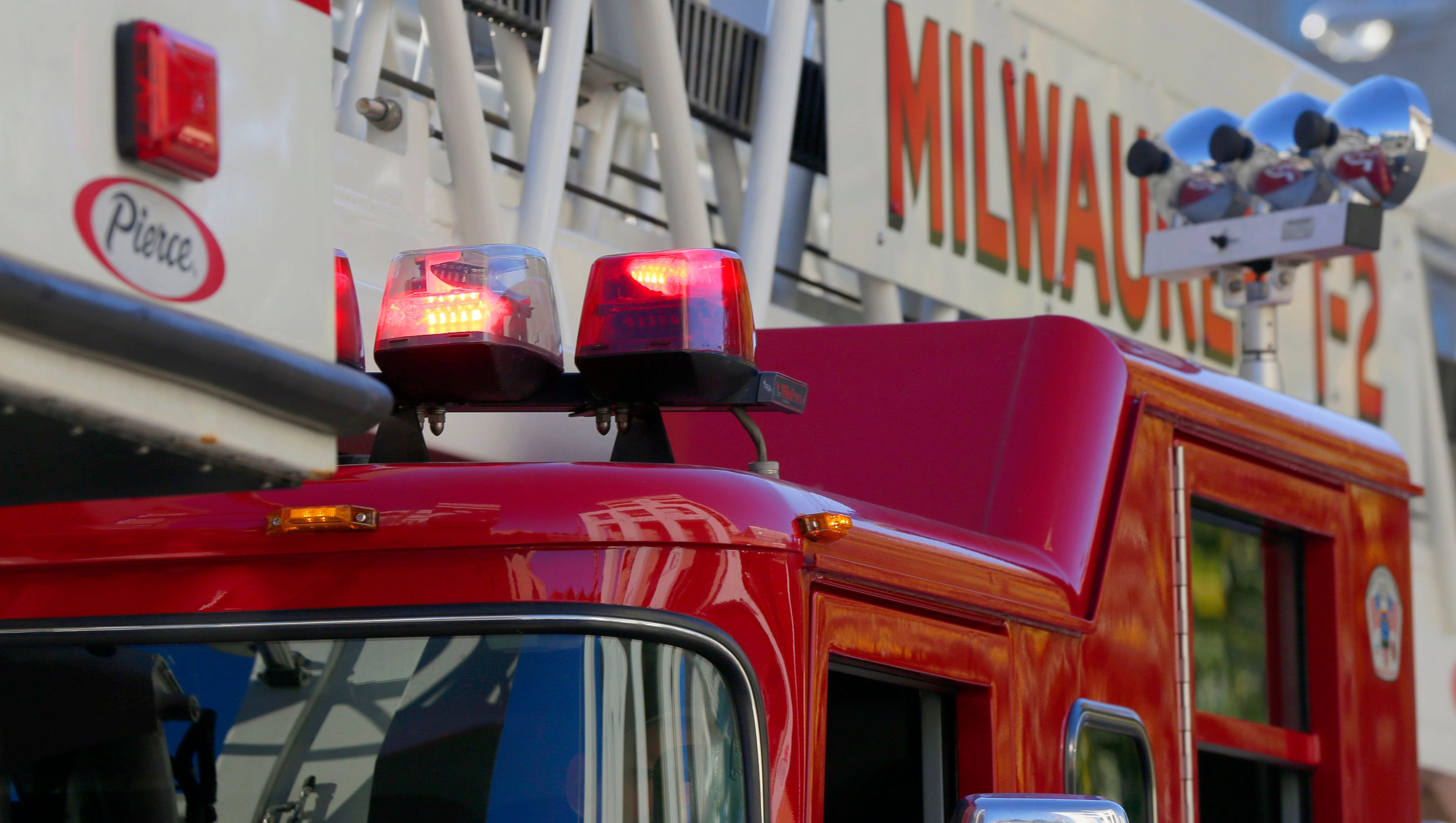 Milwaukee firefighters battle blaze at north side Family